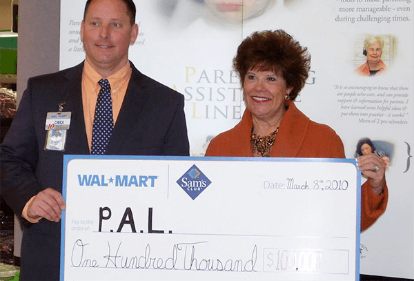 PAL employee receiving money from a donor
